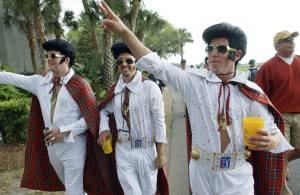 A trio of Elvis impersonators with tartan capes, from left, Shane Allison, Dean Pirtle and Matt Raven wave to fans as they walk along the 18th fairway during the third round of the Verizon Heritage at Harbour Town Golf Links on Hilton Head Island, South Carolina, Saturday, April 19, 2008. The three were declared the winners of the tournament's Tartan Day competition. (Jay Karr/The Island Packet/MCT) ORG XMIT: 1057191