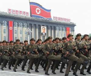 North Korean soldiers parade in front a portrait of former North Korean President Kim Il-sung during a military parade in Pyongyang's central square in this photo taken by Kyodo on September 9, 2011 marking the 63rd anniversary of the state's founding. REUTERS/Kyodo